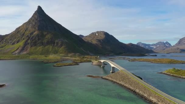 fredvang bridges lofoten islands is an archipelago in the county of nordland norway is known for a distinctive scenery with dramatic mountains and peaks open sea and sheltered bays