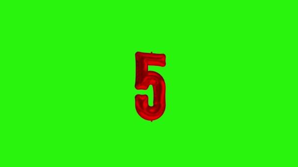 Číslo 5 pětiletá oslava červený křídlák balón plovoucí na zelené