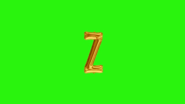 Golden letter Z. Gold foil helium balloon alphabet floating on green screen