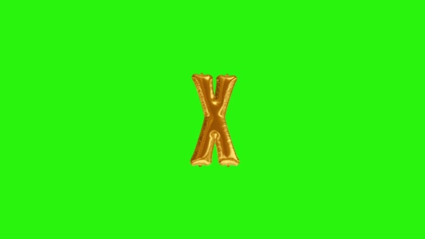 Golden letter X. Gold foil helium balloon alphabet floating on green screen