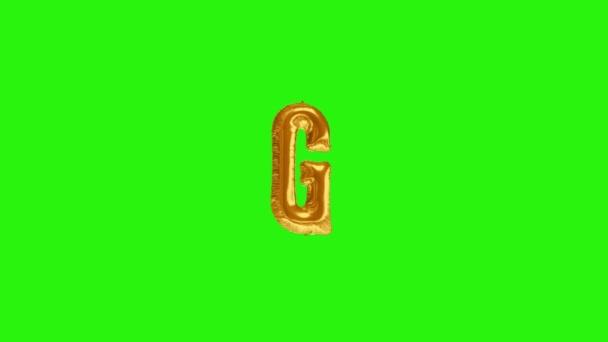 Golden letter G. Gold foil helium balloon alphabet floating on green screen