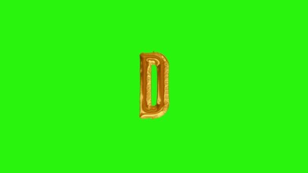 Zlaté písmeno D. Zlatá fólie helium balón abeceda plovoucí na zelené obrazovce
