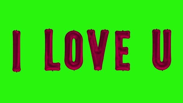 slova I Love U z helium červené fólie balón písmena plovoucí na zelené obrazovce