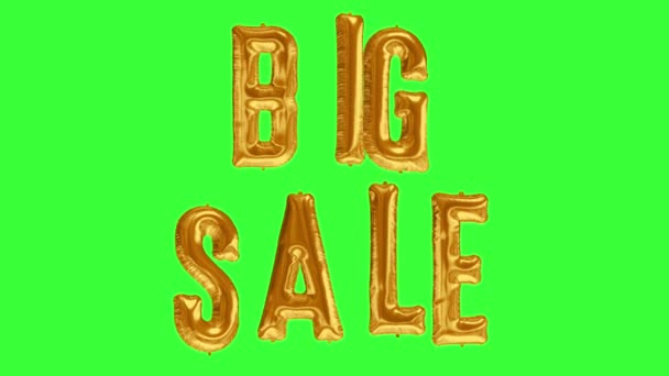 Floating BIG SALE made from gold foil balloon on green screen background