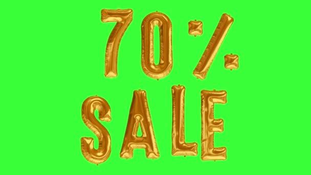 Floating Sale 70 Prozent Rabatt-Preis aus Goldfolie Ballon auf grünem Bildschirm