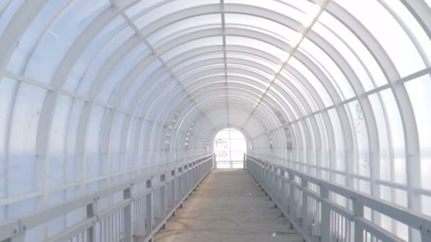 indoor pedestrian overpass with a semi-circular ceiling made of plastic