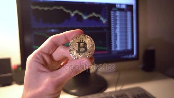 Mans Hand Holding Gold Bitcoin On Stock Market Chart Bitcoin Symbol