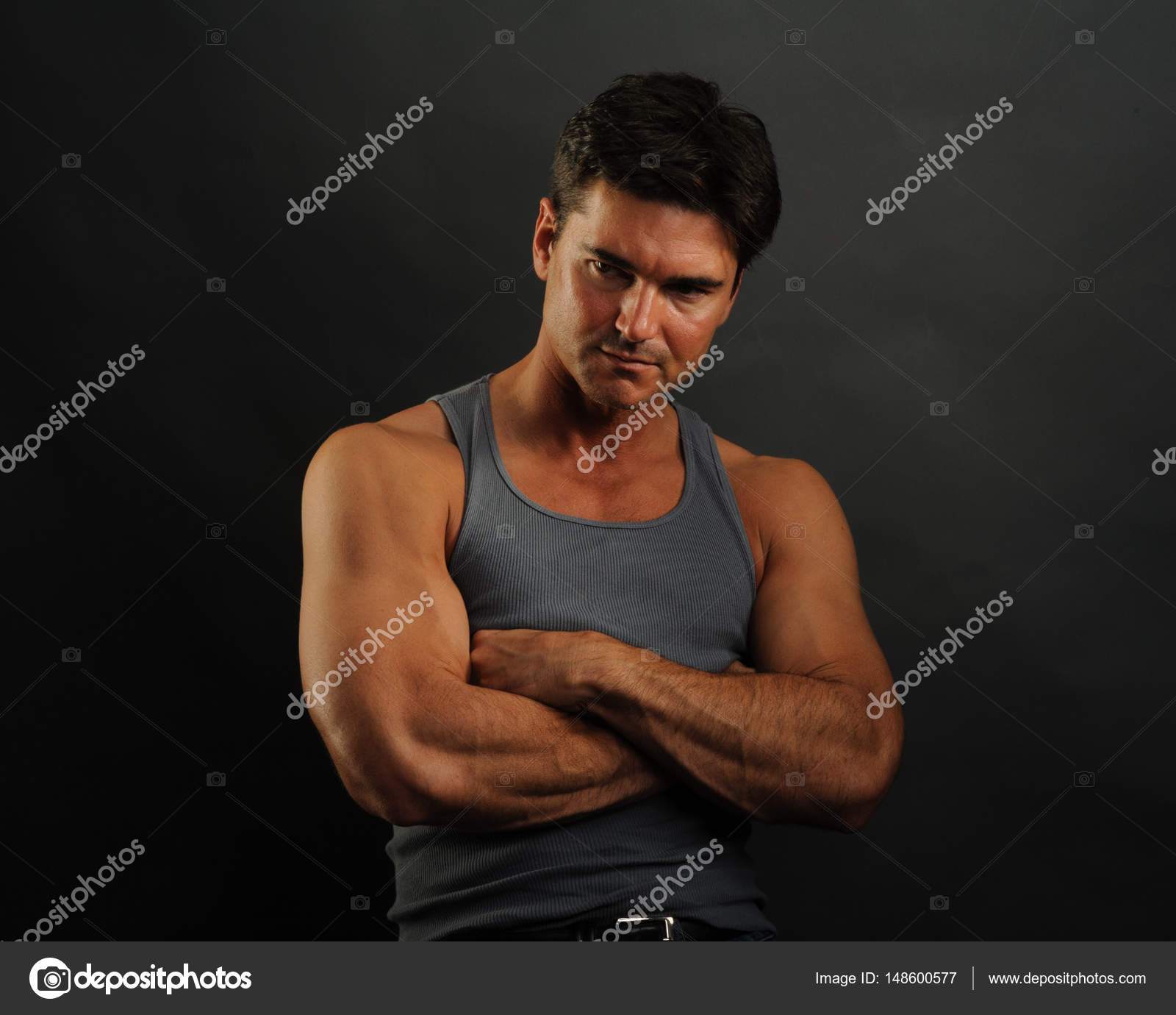 b403757d7c9b3 The handsome man is wearing a tank top — Stock Photo © romancephotos ...