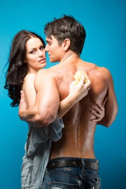 The sexy couple shares an embrace together.
