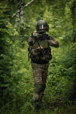 Military man with gun, helmet