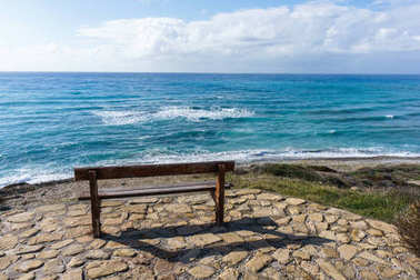 Photo of bench on background of sea