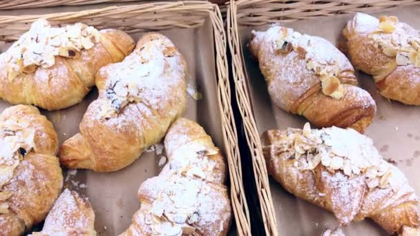 Freshly backed croissants In A Basket On Showcase, In The Store. Daily breakfast. Bakery products. homemade bakery on display for customers