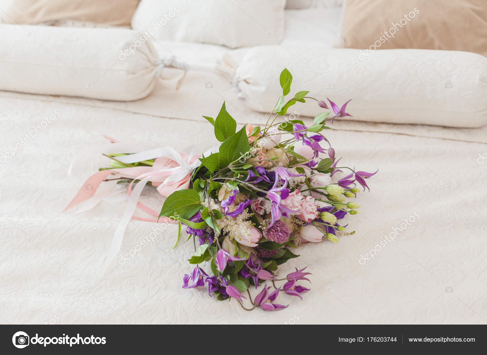 On the bed is a bouquet of flowers. — Stock Photo © kladyk #176203744