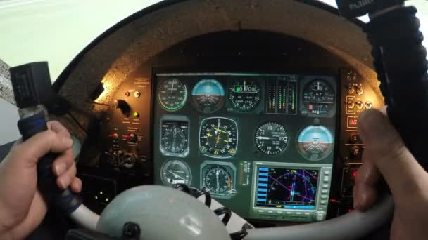 Flight simulator control panel, male hands holding airplane steering wheel