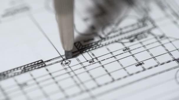 Engineer drawing detailed building plan at construction bureau