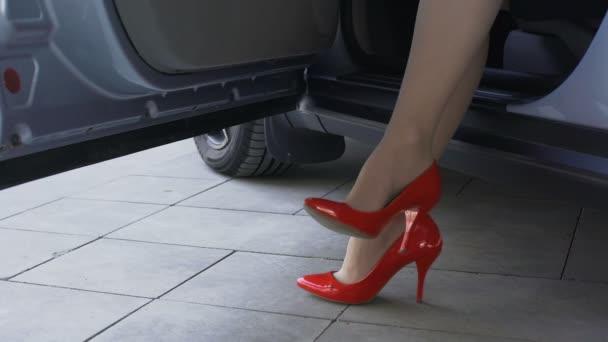 580ffc669 Slim female legs in red shoes, rich lady sitting in car, waiting for  boyfriend– stock footage