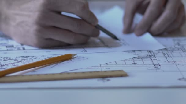 Architect checking building guidelines drawing design bureau hands