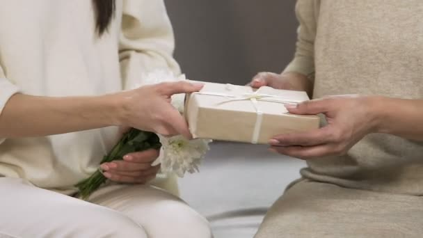 Woman Greeting Female Friend Birthday Present For Beloved Teacher Taking Care Stock Footage