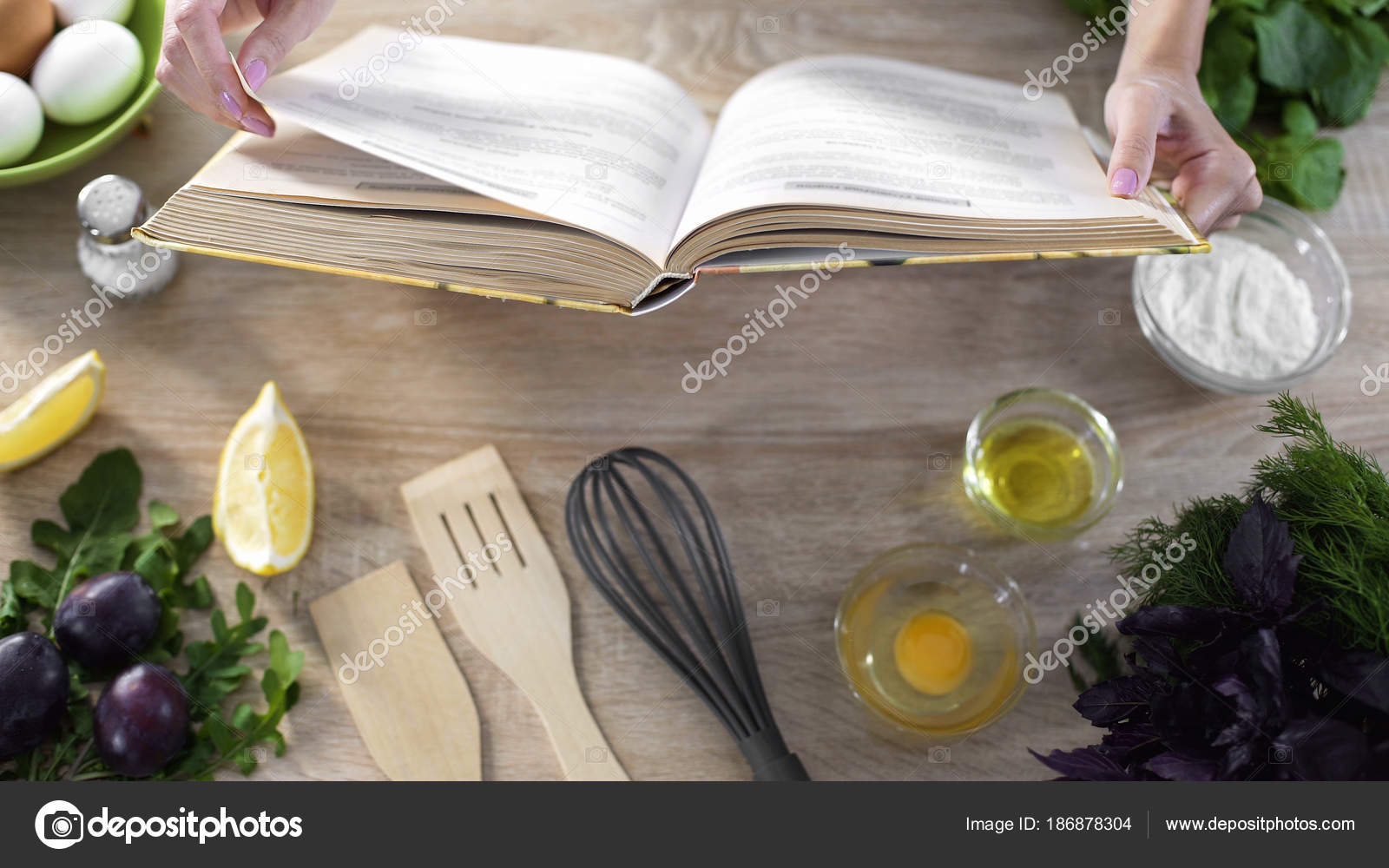 Woman Hands Holding Cooking Book Table Girl Choosing Recipe For - Book table for dinner