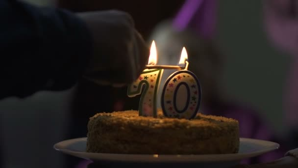 Happy 70 Years Old Woman Blowing Out Candles On Birthday Cake At Home Party Stock Footage