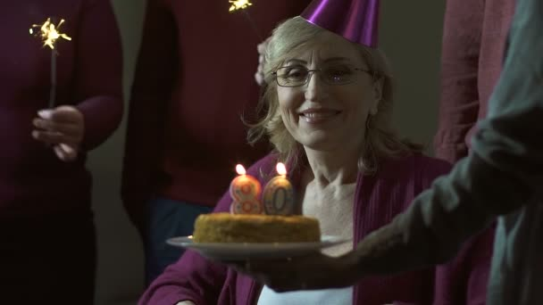 Senior Woman Blowing Out Candles On Cake And Smiling Celebrating 80 Birthday Stock Video
