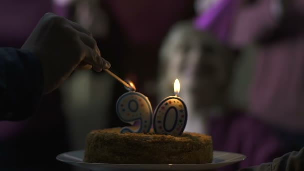 Male Hand Lighting Candles On Cake For 90 Years Old Mother Birthday Family Care