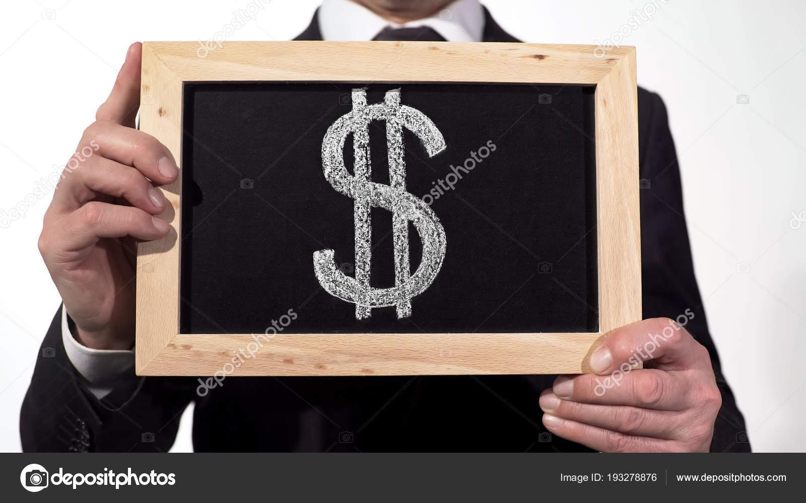 Us Dollar Symbol On Blackboard In Businessman Hands World Currency