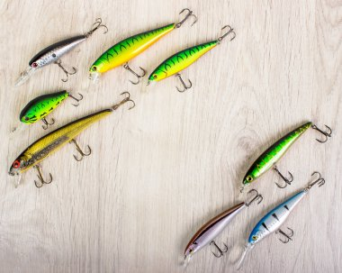 Fishing lures on a wooden background