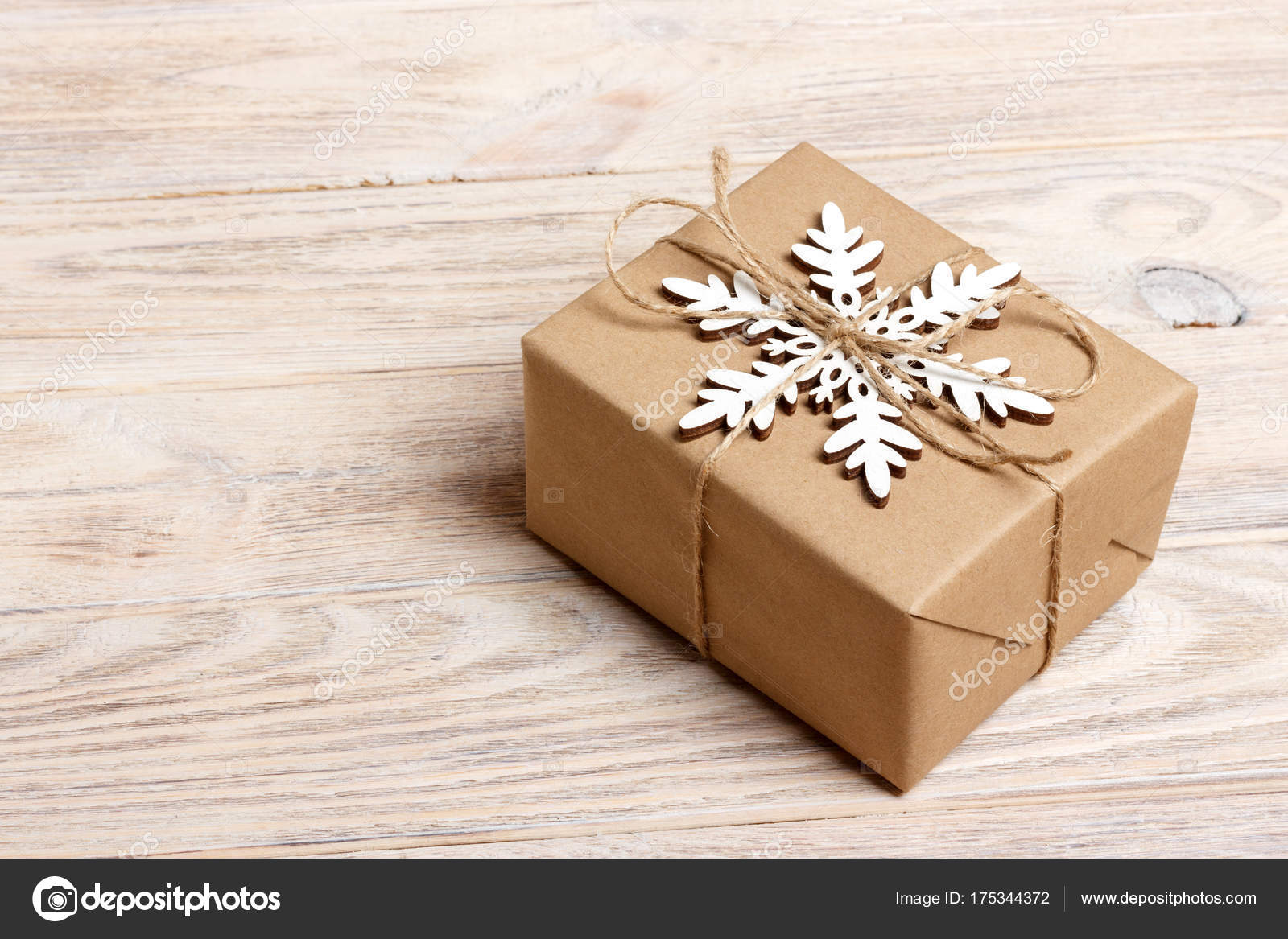 Christmas Handmade Gift Box Decorated With Craft Paper And White Snowflake On Wooden Background Top