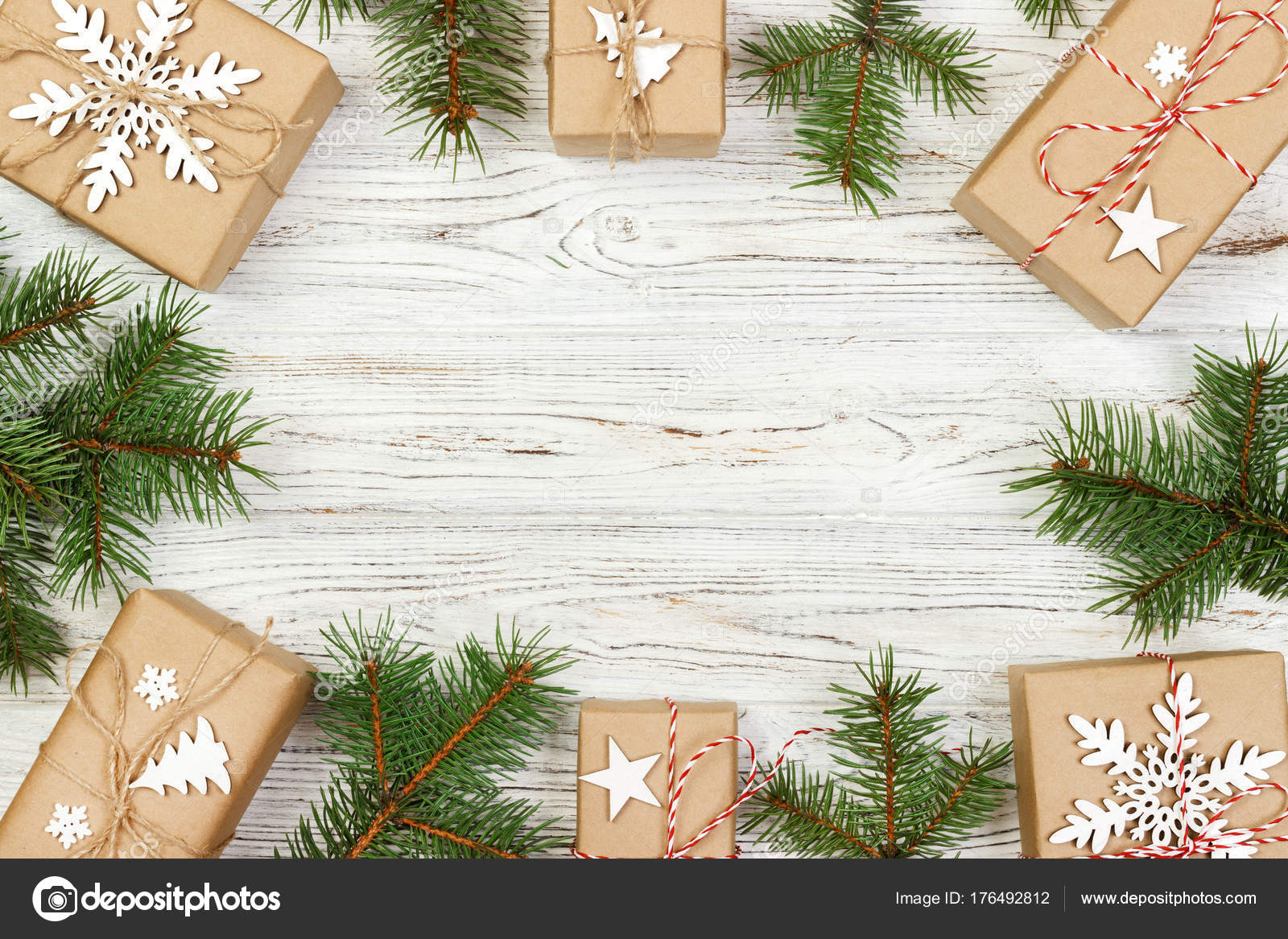 creative arrangement christmas frame. craft gift boxes and green ...