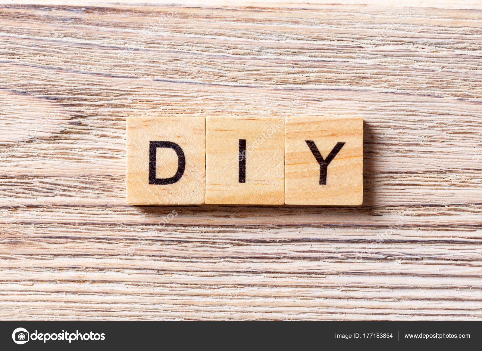 Diy word written on wood block do it yourself text on table diy word written on wood block do it yourself text on table concept solutioingenieria Gallery