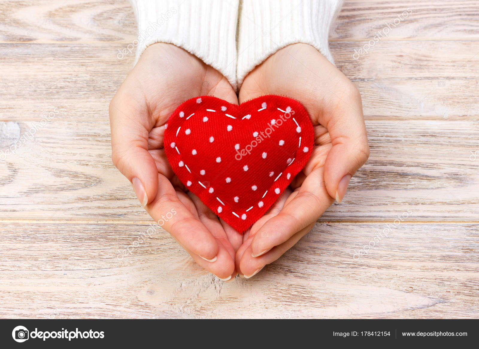 A woman holds a red heart in her hands. Love concept — Stock Photo ...