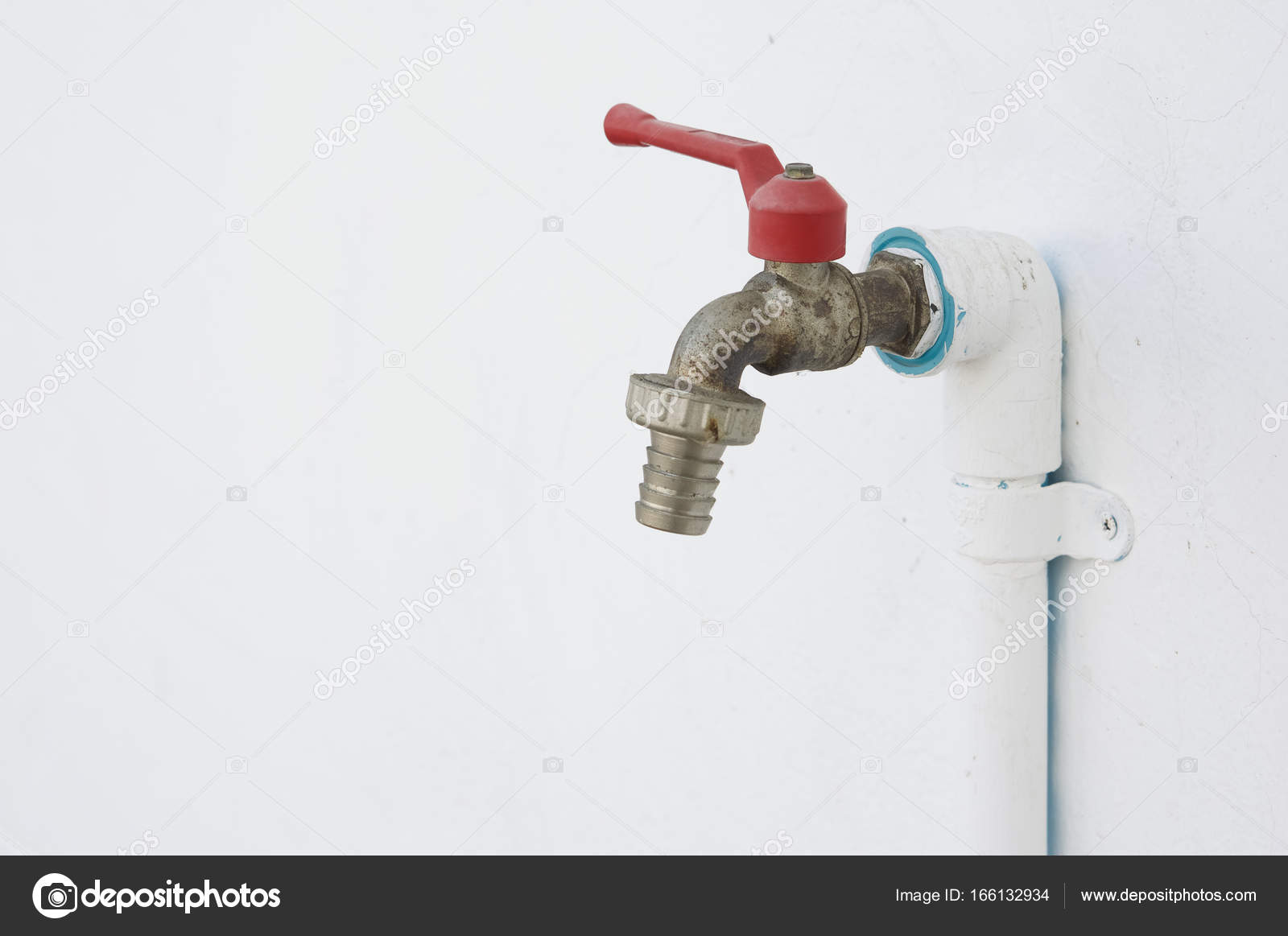 Old and rust chrome faucet with pvc pipeline painted white — Stock ...