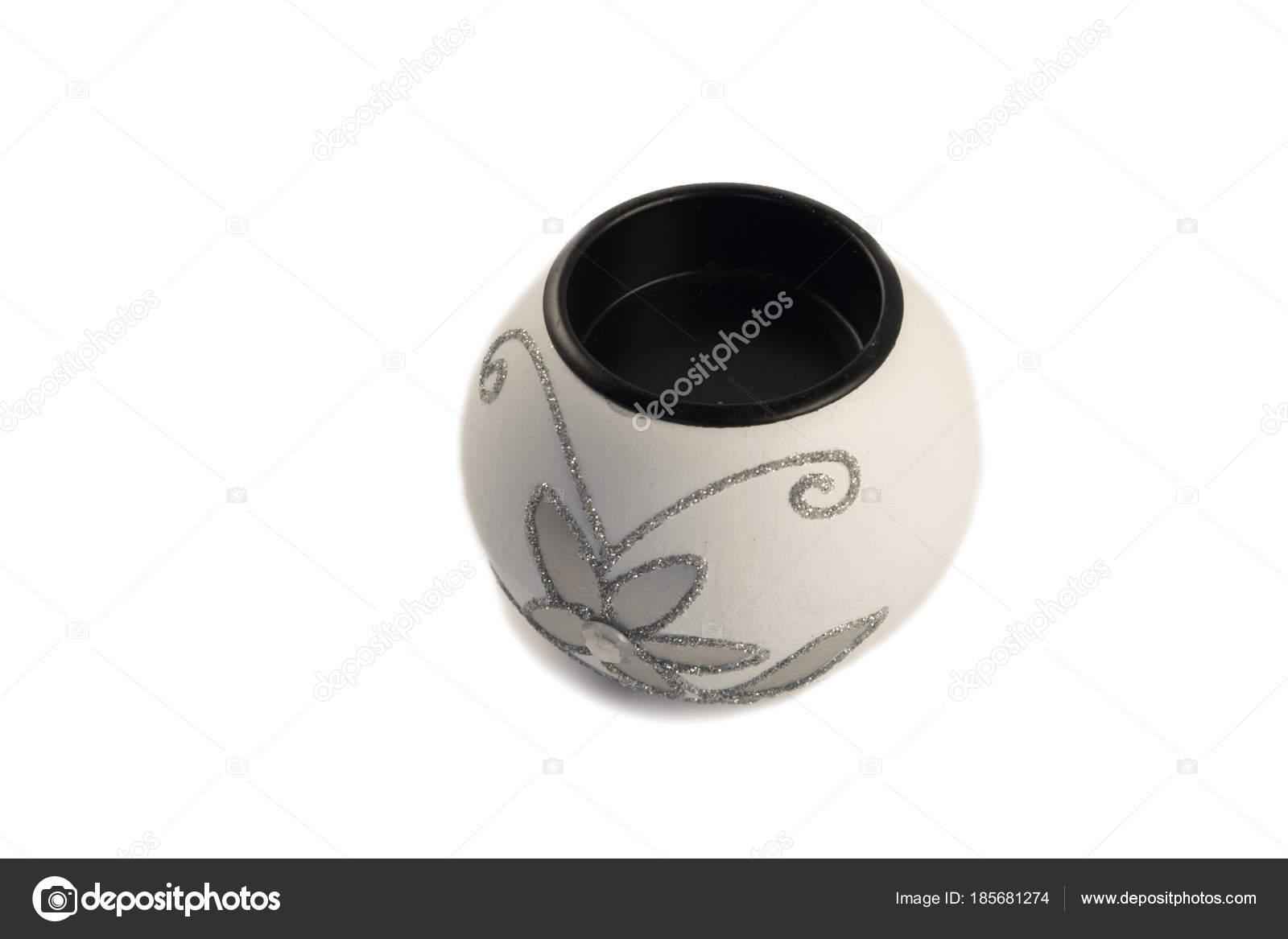 Candela bianca con la candela a forma di palla illuminazione su