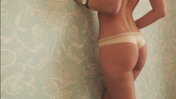 Sliming booty backside close up naked woman slow motion erotica lingerie 4K.