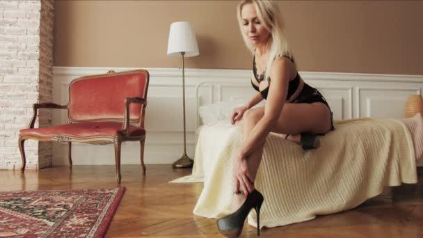 Woman in lingerie beauty touch hand leg heels erotica slim body slow motion 4K.