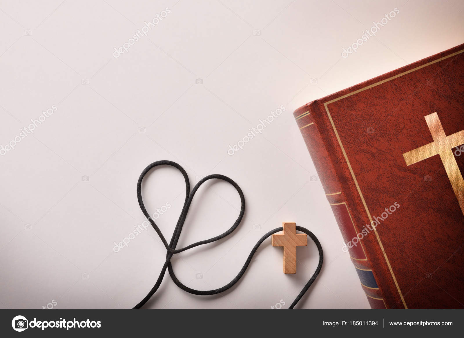 Bible With Cross Shaped Pendant And A Heart Shaped Cord Stock