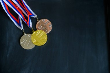 Gold, silver and bronze medal. Medal set on black background, sport photo, black edit space