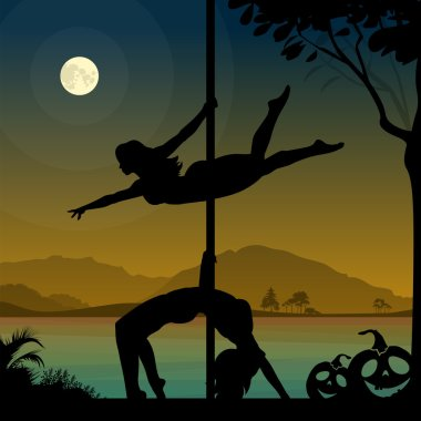 Silhouettes of two female pole dancers performing pole moves in front of river and full moon at Halloween night