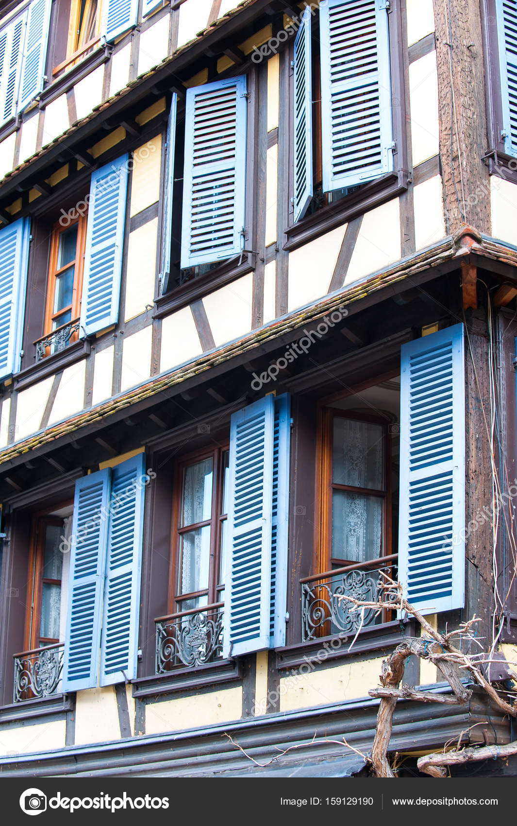 French Provencal Style Windows With Blue Wooden Shutters