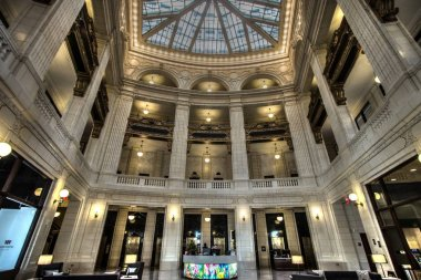 Detroit, Michigan, USA - March 28, 2018: The interior of the David Whitney Building in Detroit. Completed in 1915, the historic landmark skyscraper features a four story atrium and boutique hotel