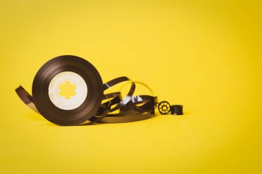 music tape over yellow background