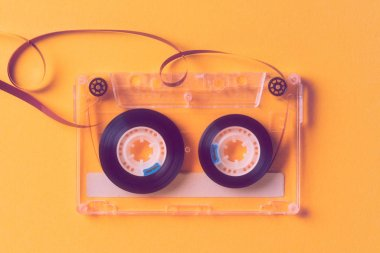 reel music tapes on a yellow background
