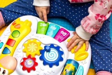 musical development for children. little girl playing educational toy