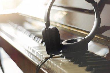 headphones on the piano