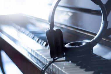 headphones on piano keys