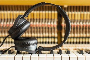 lonely lying headphones on the piano keys