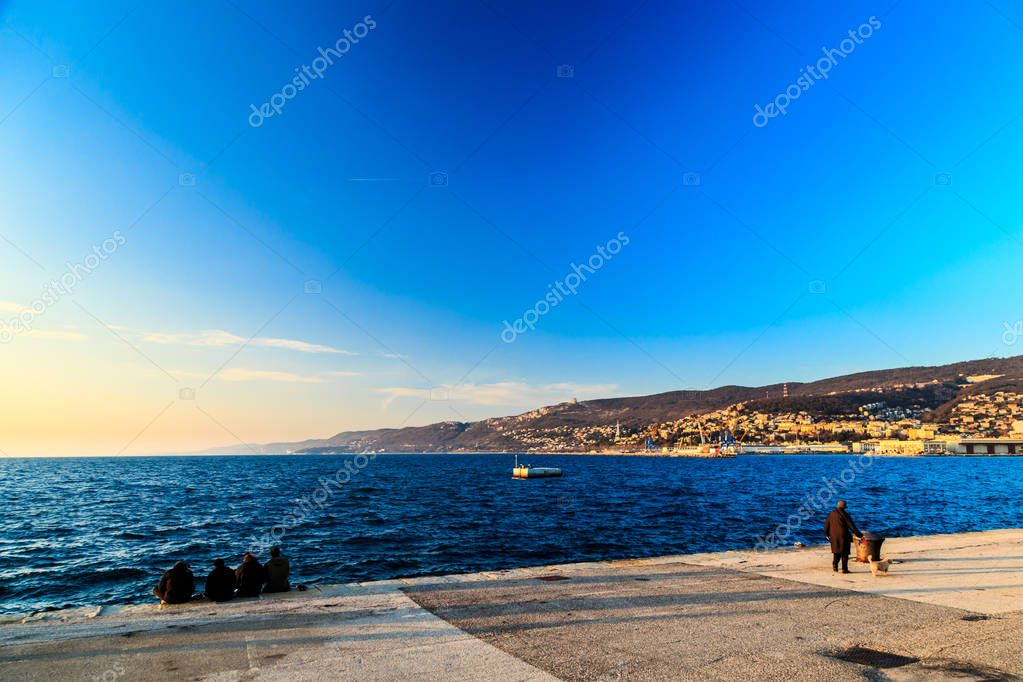 Colorful sunset in front of the city of Trieste