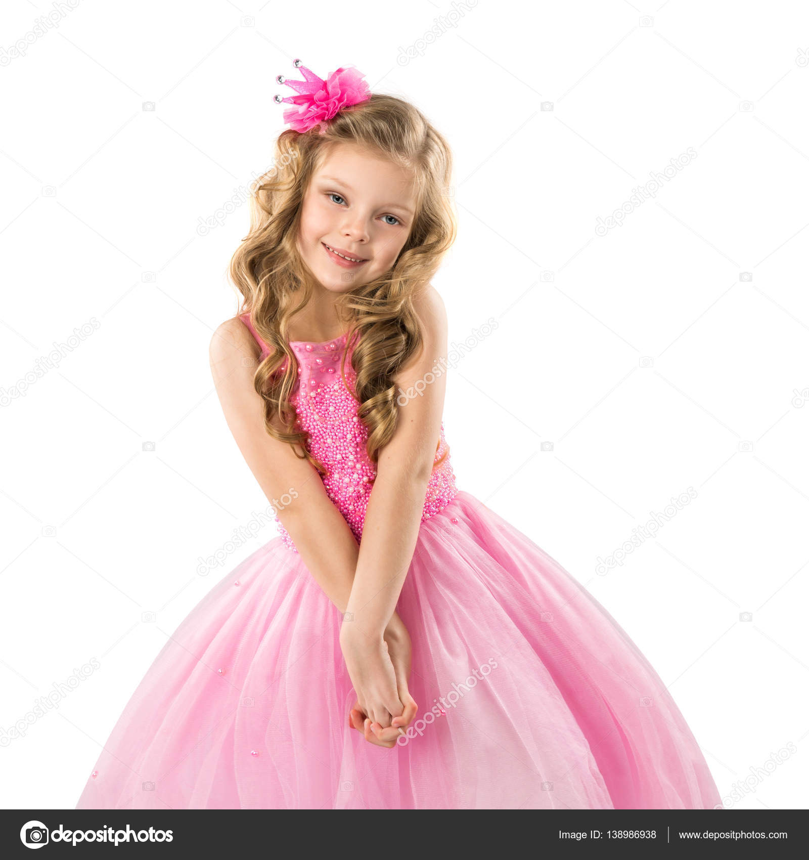 Niña linda en vestido de princesa rosa, aislado sobre fondo blanco ...