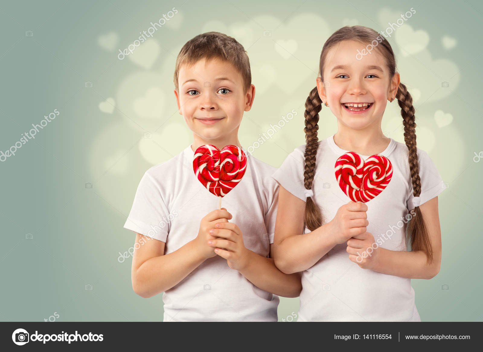 Little boy and girl with candy red lollipop in heart shape ...